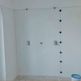 Leveling system for wall tiles